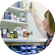 The Cat Clinic staff member shelving medication in clinic pharmacy